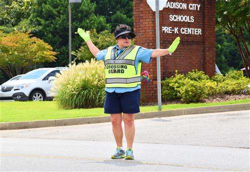 Crossing guard in front of school intersection