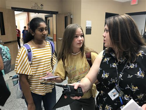 Students getting directions from teacher at Liberty Middle