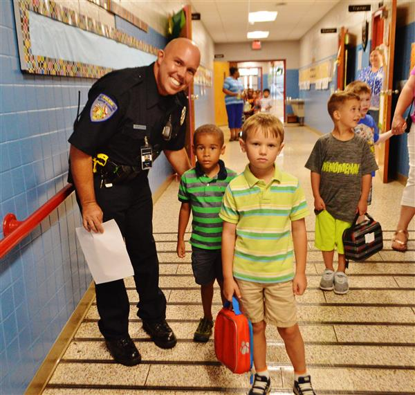 SRO Officer with kids in hallway