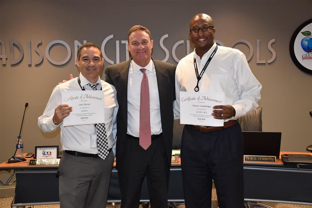 Luis Ferrer and Travis Cummings pictured with Superintendent Robby Parker