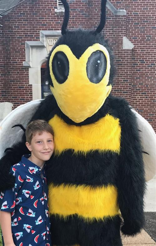 Student with hornet mascot at Madison Elementary