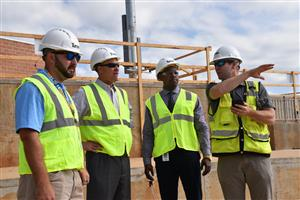 Construction officials with Superintendent Robby Parker