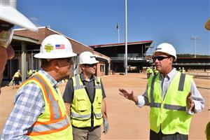 Superintendent Parker with Team Owner Ralph Nelson and a Turner Universal official inside unfinished stadium