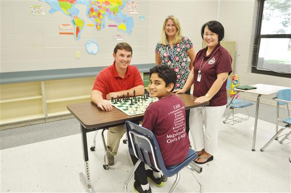 Ranae Bartlett with chess students in a classroom