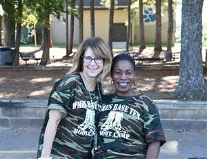 Principal and teacher in camouflage