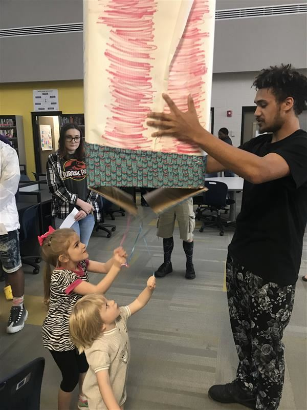 Student demonstrates his idea for a gender reveal business.