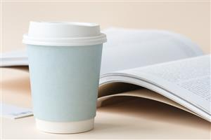 Open book and coffee cup