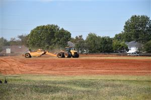 Earth mover grading site