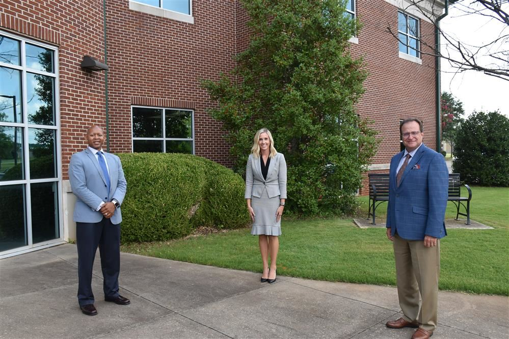 Savanna Demeester outside the Central Office with Eric Terrell and Dr. Ed Nichols