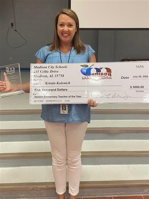 Kristin Kolenich is the Elementary Teacher of the Year. She works at Heritage Elementary and was awarded a $5,000 check