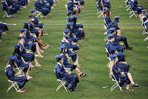 Graduates seated in rows in their caps and gowns