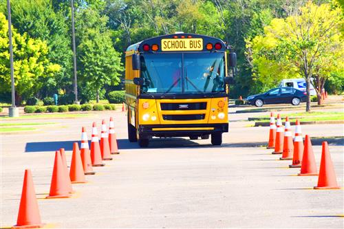 bus driving through traffic cones