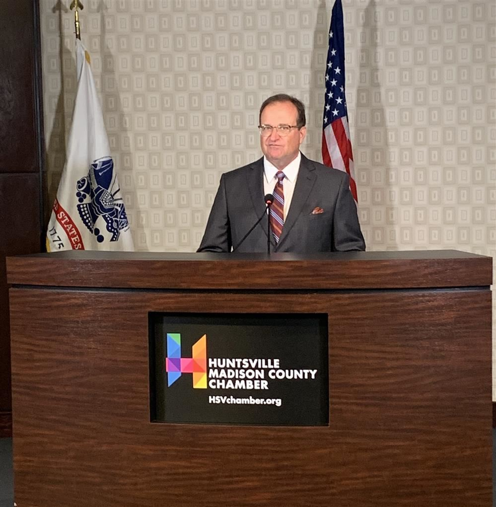 Dr. Nichols at the podium of the joint news conference