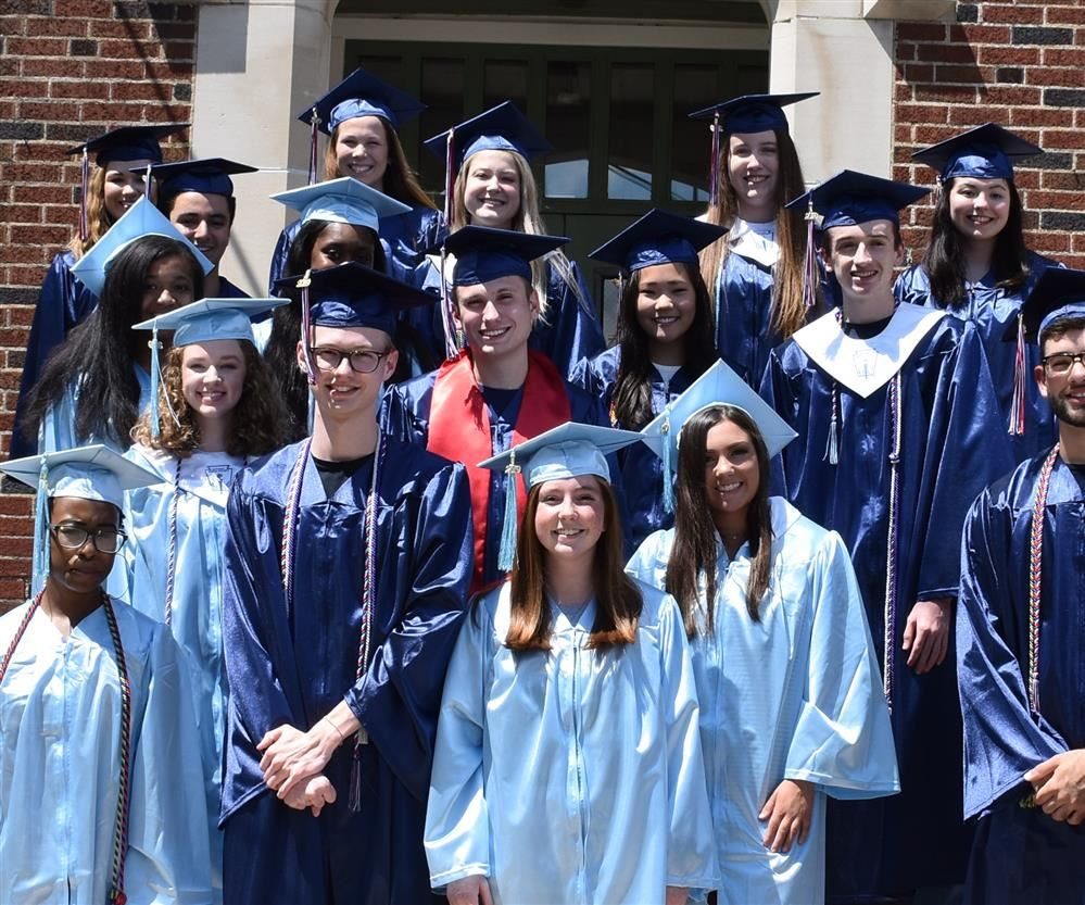 group file photo of about a dozen 2019 Bob Jones and James Clemens seniors  at Madison Elementary