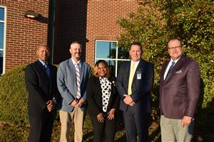 Group photo of Madison City Board of Education members, Mayor Finley, Superintendent Nichols, and several other leaders.