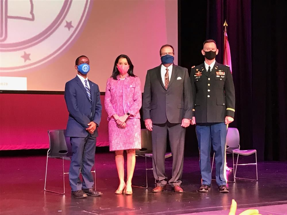 Three superintendents on stage with the Redstone Arsenal Garrison Commander