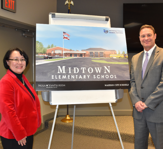 Architect rendering of new Midtown Elementary shown with Robby Parker and Ranae Bartlett