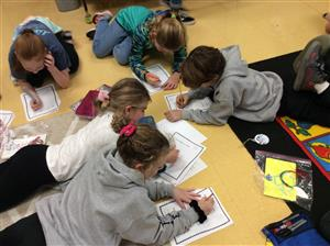 students fanned out at tables writing thank you letters to military families