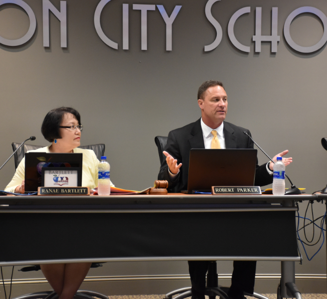 Superintendent Robby Parker at Board table with BOE President Ranae Bartlett
