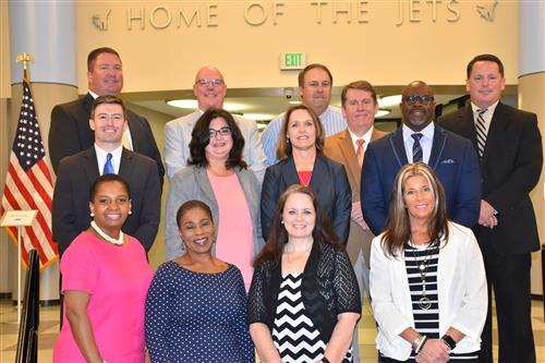 Group photo of principals of Madison City Schools, 13 in total