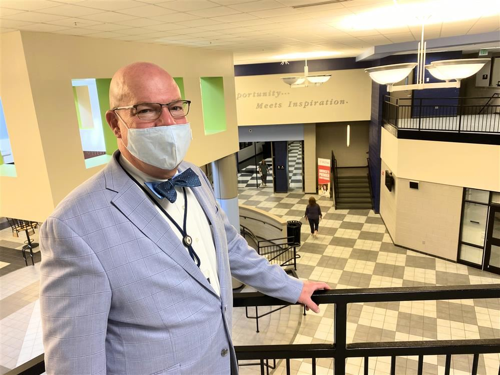 Principal Dr. Brian Clayton overlooking an empty main lobby at James CLemens High School